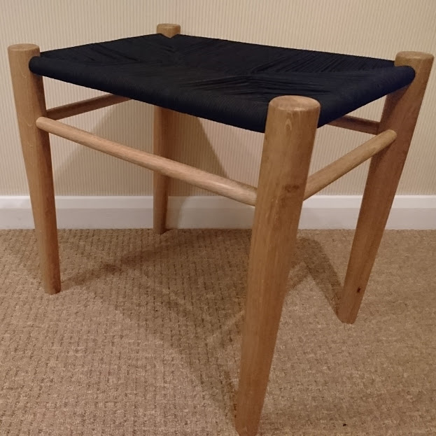 Woodturned oak stool with a woven paracord seat