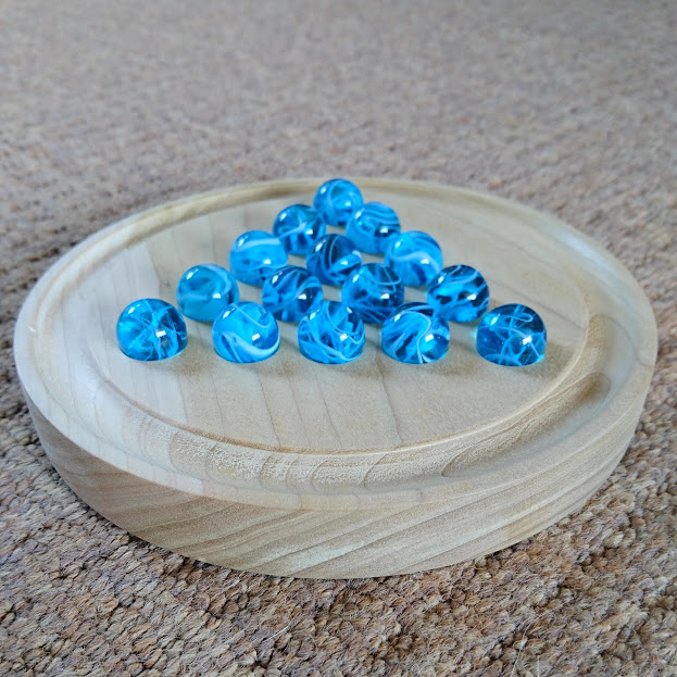A tulipwood prototype of a marble solitaire game